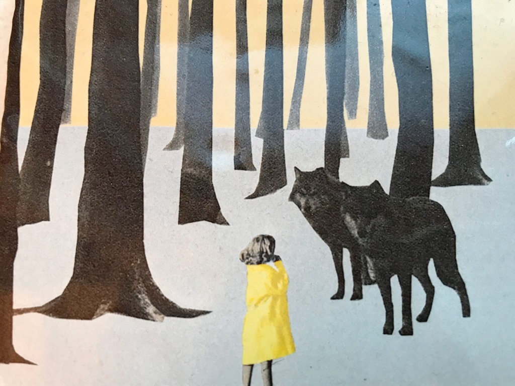 Image of girl meeting wolves in a forest