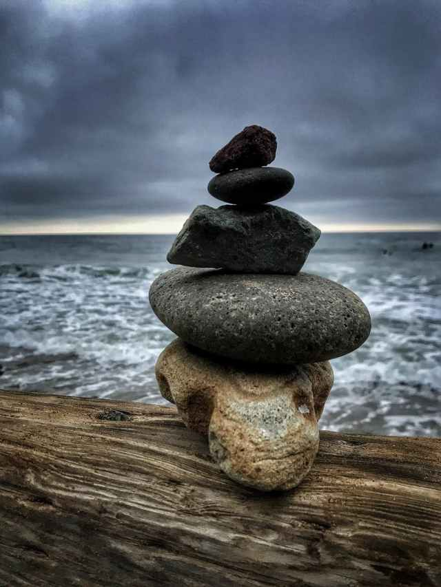Stone balancing by the water